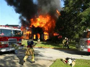 Firefighters fighting a house fire