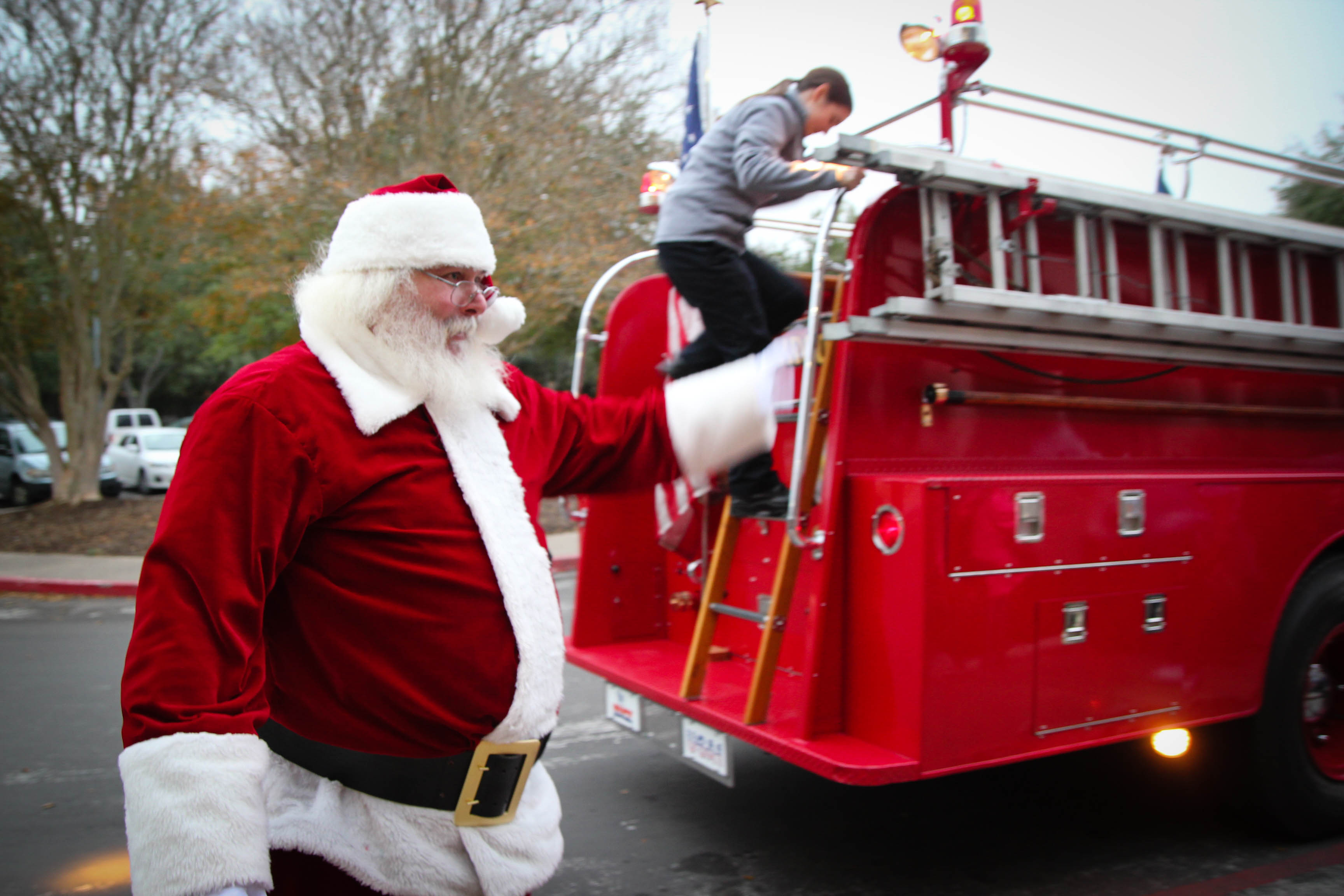 Santa Standing by a Fire Truck