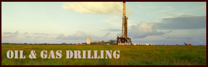 Oil Drilling Rig in a Field