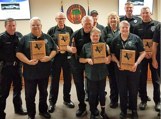 LCPD group with award plaques