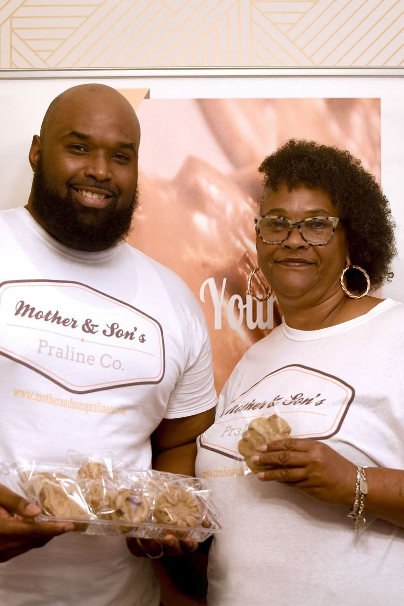 mother and son posing with pralines