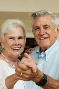 old couple posing while dancing