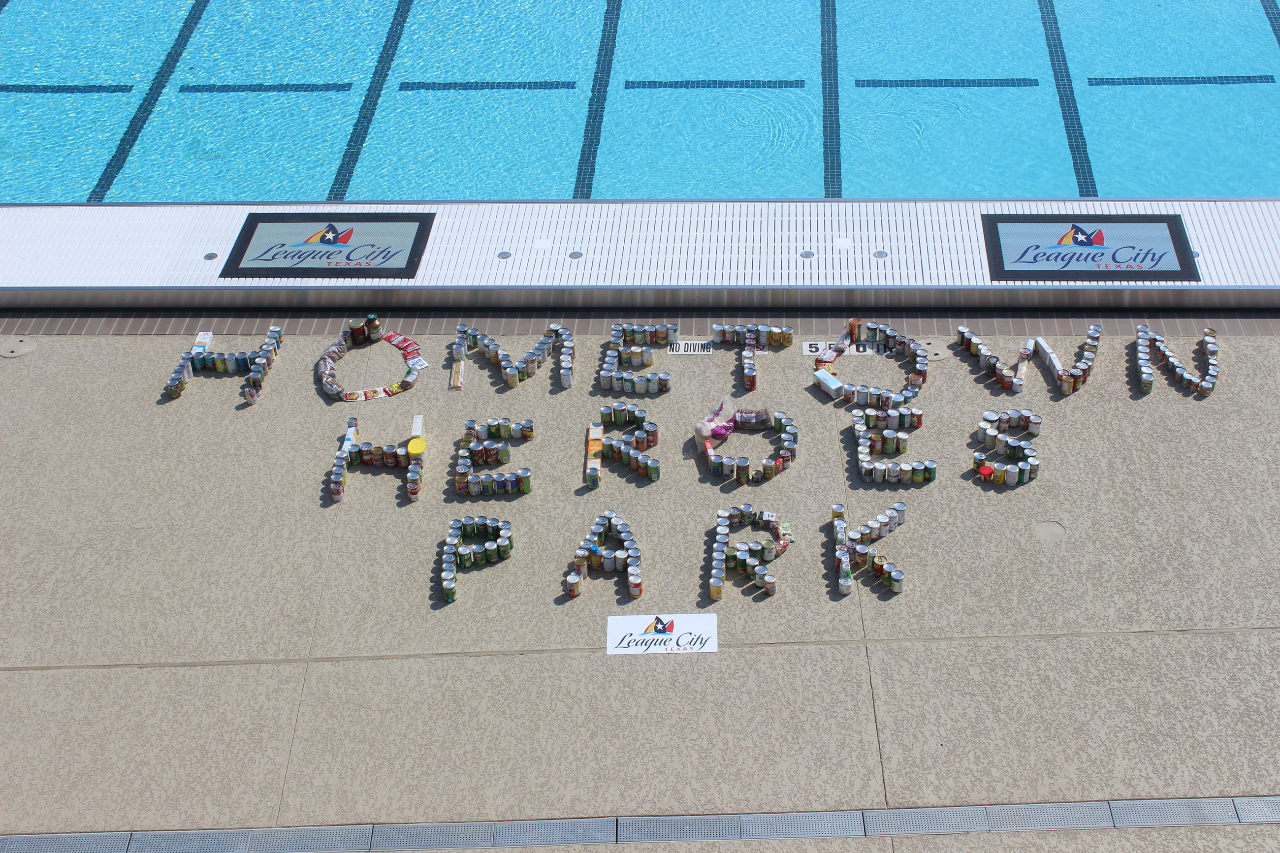 Photo that spells out Hometown Heroes Park on the pool deck