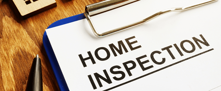 Home inspection form with clipboard and pen