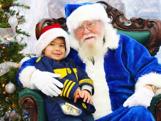 Picture of young boy with Blue Santa