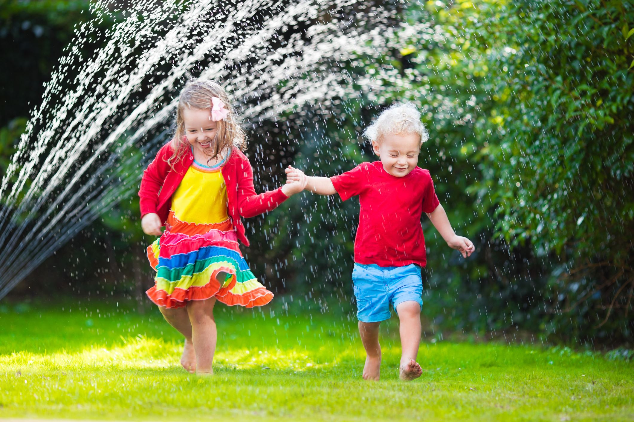 Children playing in the sprinkler