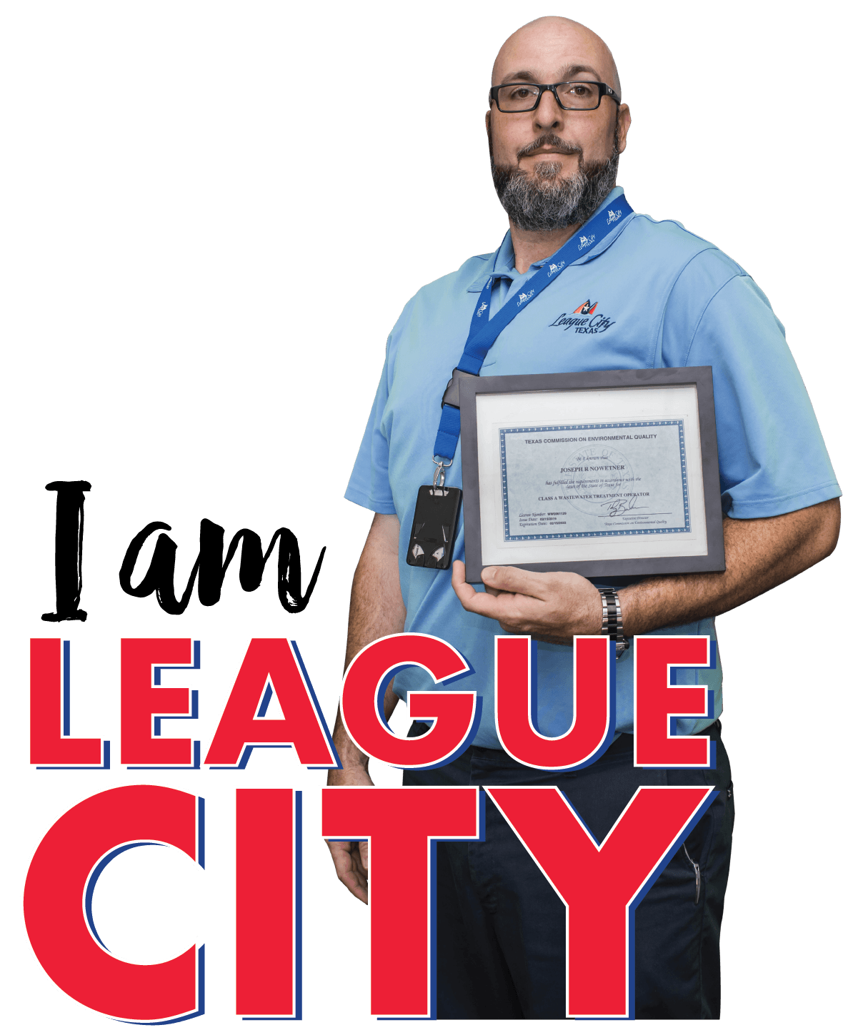 bald guy with beard posing with a framed certificate