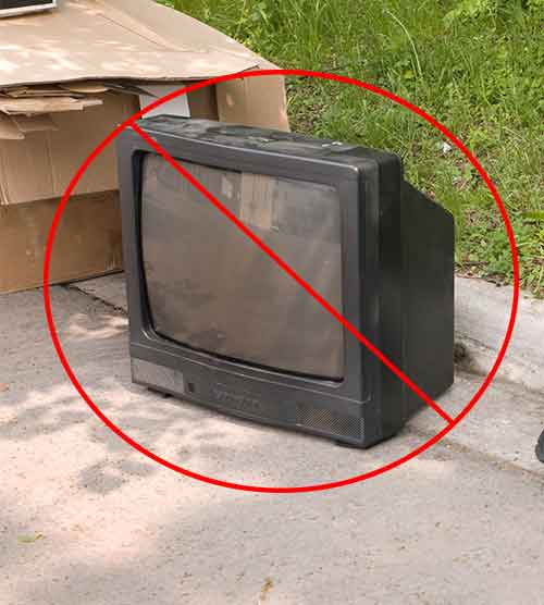 Television on curbside waiting to be picked up for trash