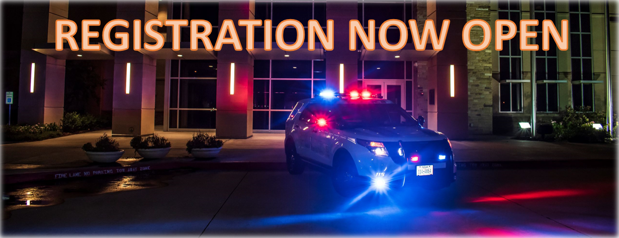 Police station at night with registration now open (image with text)