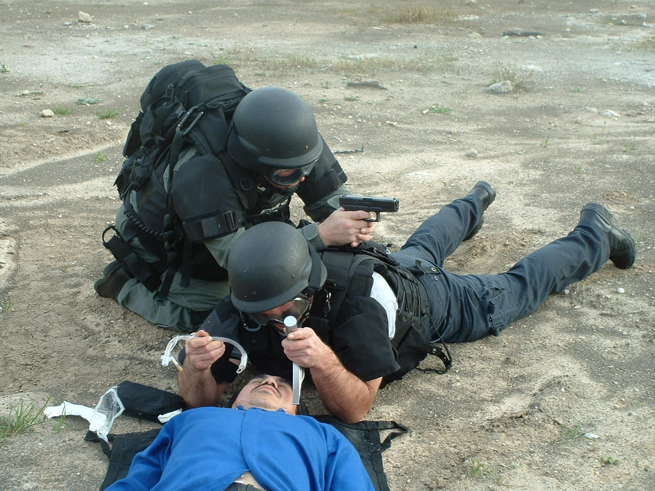 Photo of Tactical support medics treating an injured man